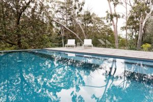 Beautiful modern backyard with frameless glass pool fence in the suburbs of Perth hills