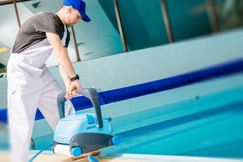 Automated Pool Cleaner :swimming pool, cleaning, work, pool, tile floor, sanitation, sanitary, slippery, floor, wet, stand, recreation, workplace, worker, swimming, horizontal, pool robot, cleaning service, labor, technician, operator, technician, automated cleaner, hose, dirty, dirt, cleaning service, labor